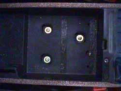 Screws inside utility tray